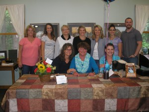 Friends and family of Jan Knudsen, aka Mrs. Lucky, joined her at the Woodgate Library on Saturday, June 27 for a book signing event celebrating the recent release of her book, Just My Luck. Back row: Holly LeDuc, Sara Ludecke, Linda D'Aprile, Annie Gilbert, Carol Kelley, Amanda Hoskins, and Alex Hollings. Seated are Lisa D'Aprile, Jan Knudsen, and Jamie Hollings. The book is $20 and available online at: 2ndhandhero.com. Photo by Marianne Christy