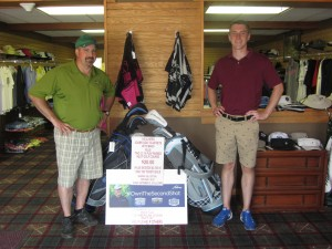 Inlet Golf Club employees Tim White and Brandon Thompson with the raffle prize of His-and-Her Sets of Adams Golf Clubs. Photo by Gina Greco