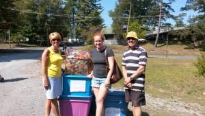 CAP-21 Board Member Sandy Booton, gift basket winner, Claire Ochmanek and CAP-21 Executive Director Nick