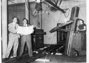 Gene at Pacemaker Steel...Romano still in his 20s, second from left, works on perfecting his steel and piping operation in Utica.