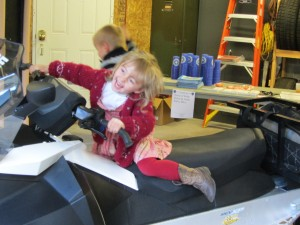 Christina Russell trying out a Webb Police snowmobile