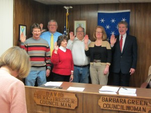 Town of Webb elected officials were sworn in for terms starting in 2016, on Monday, January 4. Being sworn in by Town Clerk Nanci Russell (foreground) are, from left, Casey Crofut, Highway Superintendent; John Graham, Town Justice; Kelly Hunkins, Tax Collector; Town Councilpersons Dave Berkstresser and Barbara Green; and Robert Moore, Town Supervisor. Photo by Jay Lawson