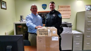 TOW Police Officer Anthony Capristo, right, receives mobile radio equipment from Sheriff Chris Farber. Courtesy photo