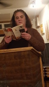 Melissa Macdonald reads a selection at Five Corners Café's January opening readings night