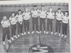 Webb Team from Don Hodel's high-scoring junior year, 1962: Shown in the old gym (current cafeteria) are, from left, L. Schmuck, D. Bishop, J. Wilkins, D. Hodel, D. Barker, P. Hansen, and D. Russell (kneeling).