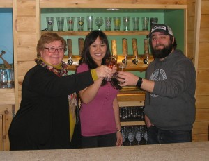 VIEW Executive Director Jennifer Potter Hayes, left, Cathy Bowsher, VIEW's assistant marketing director, & FCCB co-owner Justin Staskiewicz toast their new event partnership. Photo by Marianne Christy