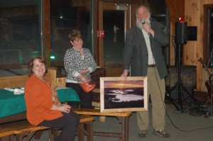 Gary Staab announces  the auction winners  with Judy Riedman  and Diane Heroux. Courtesy photo