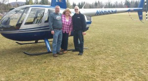 Keith and Denise Wenhold and Tom Bamford take a helicopter ride at this year's Snofest.