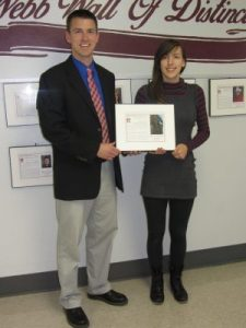 Webb Principal John Swick presents the Wall of Distinction award to Rebecca Sessions. Photo by Gina Greco