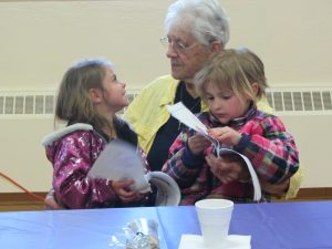 SHARP senior Jan Egenhofer with kindergartners C. Lynch and N. Hitchcock at the Wednesday, April 20th SHARP program at Niccolls Church. Photo by Gina Greco